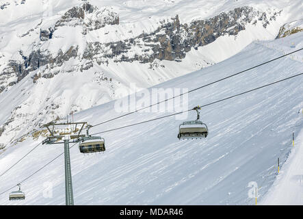 A wintertime view on Mt. Titlis in Switzerland. The Titlis is a mountain, located on the border between the Swiss cantons of Obwalden and Bern, it is  - Stock Photo