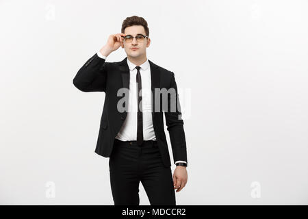 Business Concept: Portrait handsome young businessman wearing glasses isolated over white background - Stock Photo