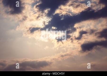 Sky cloud gray tone. the sun shines through the feathery clouds in the blue sky retro toning. - Stock Photo