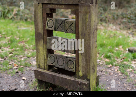 Wooden carved game of noughts and crosses in a children's playground on Dunstable Downs, Hertfordshire UK - Stock Photo