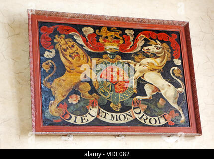 The Royal Arms of George 111 over the south porch door in the parish church of St Mary the Virgin at Wiveton, Norfolk, England, United Kingdom. - Stock Photo