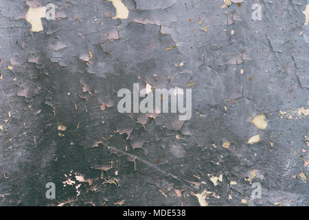 Old gray cracked paint on the cement wall - Stock Photo