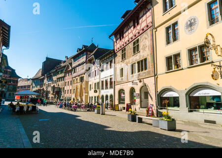 town square of Stain Am Rhein with typical architecture and fresco painting on a beautiful and busy spring day - Stock Photo