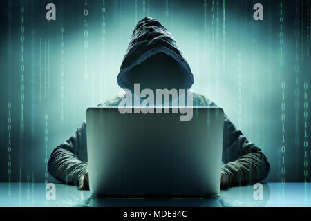 Faceless Anonymous Computer Hacker With Laptop - Stock Photo