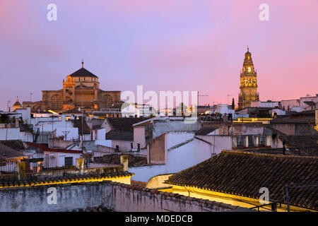 The Mezquita and Torre del Alminar belfry floodlit over roof tops at dawn, Cordoba, Andalucia, Spain, Europe - Stock Photo