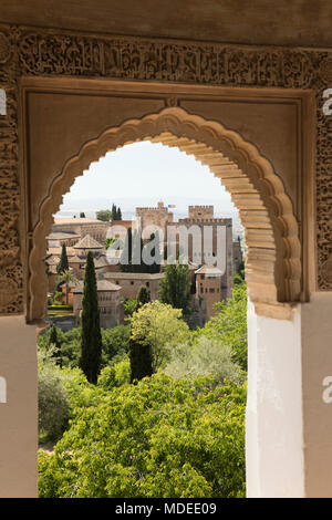 View over the Alhambra through Islamic style arch, The Alhambra, Granada, Andalucia, Spain, Europe - Stock Photo