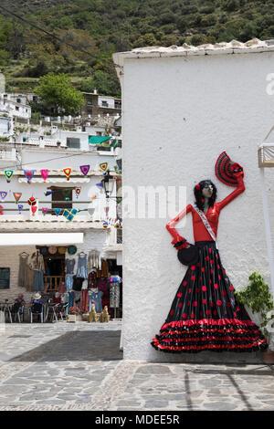 Mock flamenco dancer on wall of white mountain village of Pampaneira, Sierra Nevada National Park, Alpujarras area, Granada Province, Andalucia, Spain - Stock Photo