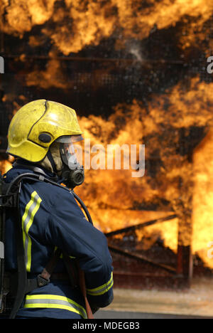 firefighting, aircraft crash, fire and flames - Stock Photo