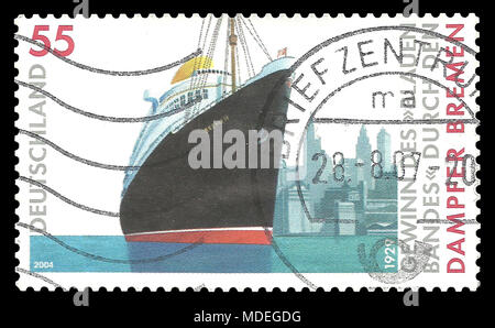 Germany - stamp 2004: Color edition on Ships, shows Passenger ship Bremen in front of cityscape of New York - Stock Photo