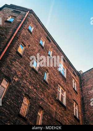 Zoom at the courtyard of an old red brick tenements house in the center of Katowice, Silesia, Poland. - Stock Photo