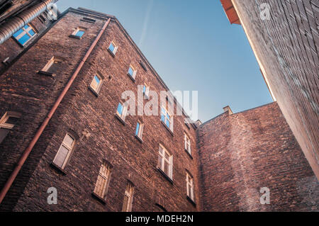 Courtyard of an old red brick tenements house in the center of Katowice, Silesia, Poland. - Stock Photo