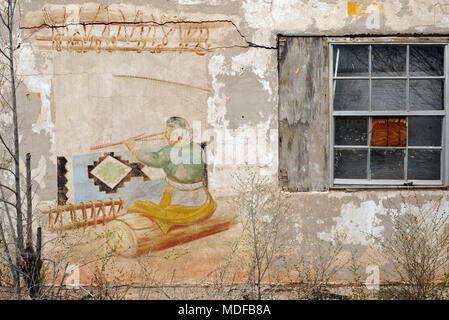 A colorful mural decorates a wall of the abandoned Bowlin's Old Crater Trading Post on Route 66 near Bluewater, New Mexico. The store closed in 1973. - Stock Photo