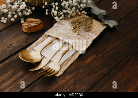Close-up of gold cutlery - Stock Photo