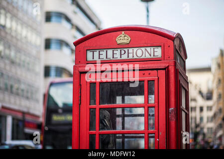 Traditional Red telephone box on a street in London, UK - Stock Photo