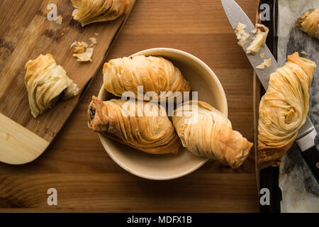 Borek is a family of baked filled pastries made of a thin flaky dough known as phyllo. - Stock Photo