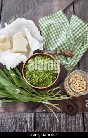 Homemade pesto with wild garlic and parmesan cheese - Stock Photo