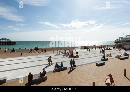 People are watching a performance of a puppet theater in Brighton, beach chairs - Stock Photo