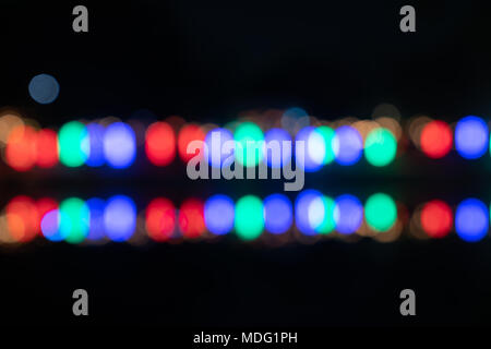 Bokeh colorful circles  background  of primary colors in two horizontal rows - Stock Photo
