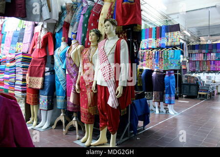 Traditional Lao clothing for sale inside Talat Sao Shopping Market in Vientiane, Laos. 2015. - Stock Photo