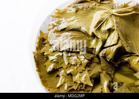 Grape or Vine Leaves in bottle of water for Turkish Dolma. Organic Food. - Stock Photo