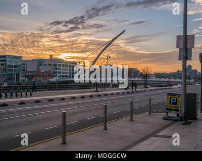 Dublin, Ireland - Dublin Quays at sunset, looking out over the River Liffey and the Samuel Beckett Bridge commonly known as the Harp Bridge. - Stock Photo