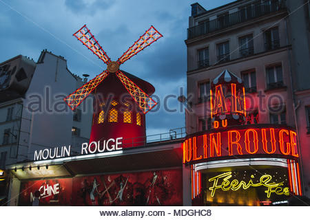 Moulin Rouge in Paris France at Blue Hour - Stock Photo