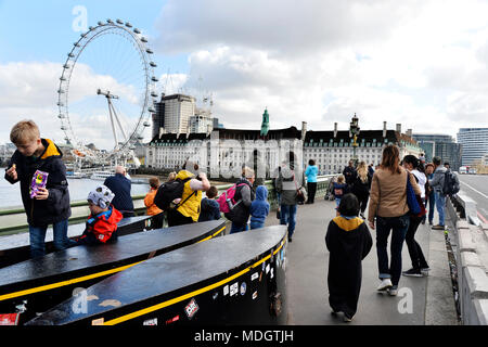 Security Bollards and London's Eye seen from Westminter Bridge - London - England - Stock Photo