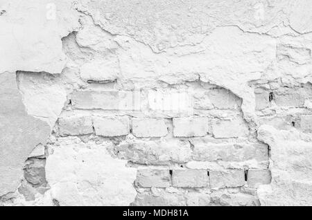 Texture of a white ruined brick wall. Grunge dirty old brick wall exterior. Weathered white textured pattern background with copy space for text. - Stock Photo