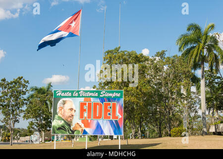 SANTA CLARA, CUBA-JANUARY 6, 2017: In the gardens of the mausoleum of guerrilla Che Guevara, there is always a flag and a poster of Fidel Castro that  - Stock Photo