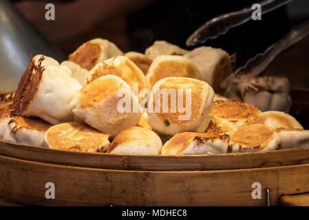 Steamed dumplings for sale on Kulangsu Island; Xiamen, Fujian, China - Stock Photo