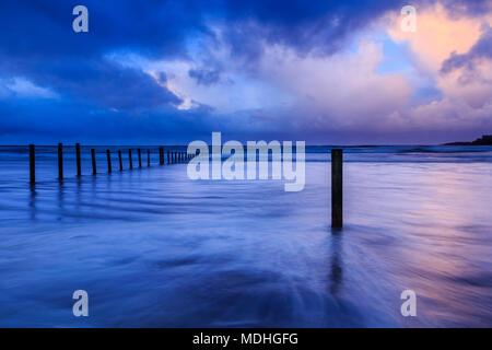 Sunset over Portstewart strand in County Derry, Ireland. - Stock Photo