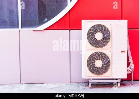 Air conditioner on wall of building outdoors - Stock Photo