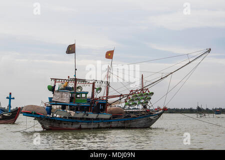 Fishing boat in the river; Hoi An, Quang Nam, Vietnam - Stock Photo