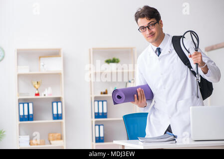 Doctor going to gym during lunch break - Stock Photo