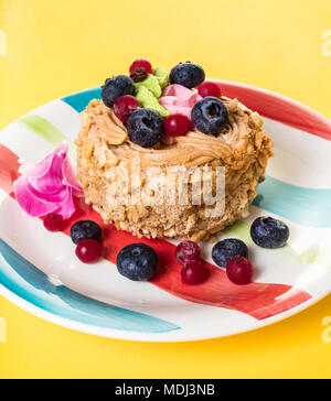 fruit dessert cake in a plate on yellow background - Stock Photo