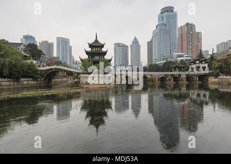 Guiyang, China - March 25, 2018: Cityscape of Guiyang at noon, Jiaxiu Pavilion on the Nanming River. Located in Guiyang City, Guizhou Province, China. - Stock Photo