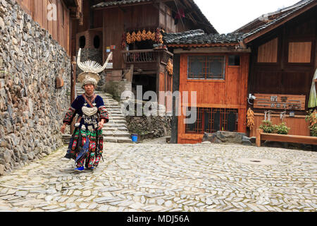 Langde, China - March 27, 2018: Miao woman wearing the traditional Miao attire in Langde Miao village, Guizhou province, China - Stock Photo