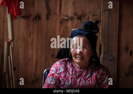 Langde, China - March 27, 2018: Old Miao woman in Langde Miao village, Guizhou province, China - Stock Photo