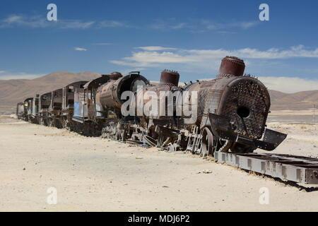 Abandoned train at Train cemetery. Uyuni. Bolivia - Stock Photo
