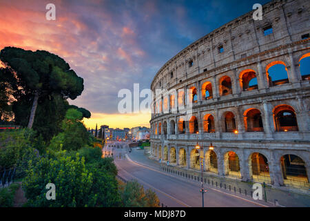 Colosseum. Image of famous Colosseum in Rome, Italy during beautiful sunrise. - Stock Photo