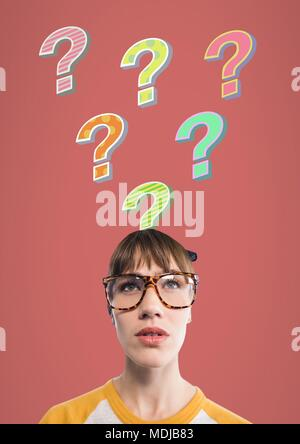 Woman with colorful funky question marks emerging from head - Stock Photo