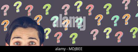 Man thinking with colorful funky question marks - Stock Photo