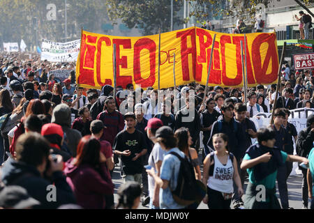 Santiago, Chile. 19th Apr, 2018. Students march for public education under the motto 'Chile already decided' in Santiago, Chile, 19 April 2018. The march was called by Chile's Confederation of Students (Confech), the National Coordinator of Secondary Students (Cones), the Coordinating Assembly of Secondary Students (Aces) and the Teachers' Association. Credit: Mario Ruiz/EFE/Alamy Live News - Stock Photo