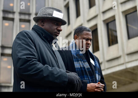 Philadelphia, USA. 19th Apr, 2018. Rev. Mark Tyler and Rev. Greg Holston, Executive Director of Philadelphians Organized to Witness, Empower and Rebuild (POWER), bow heads in prayer at a Police Accountability rally hosted by POWER outside Police Dept. headquarters in center City Philadelphia, PA, on April19, 2018. Credit: Bastiaan Slabbers/Alamy Live News - Stock Photo