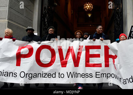 Philadelphia, USA. 19th Apr, 2018. Religious leaders and clergymen with Philadelphians Organized to Witness, Empower and Rebuild (POWER) hold a Police Accountability rally, followed by a protest march starting at Philadelphia Police Dept. headquarters and ending at City Hall in center City Philadelphia, PA, on April19, 2018. The protest is a reaction to the recent controversial arrest at a Center city Starbucks of two black men. Credit: Bastiaan Slabbers/Alamy Live News - Stock Photo