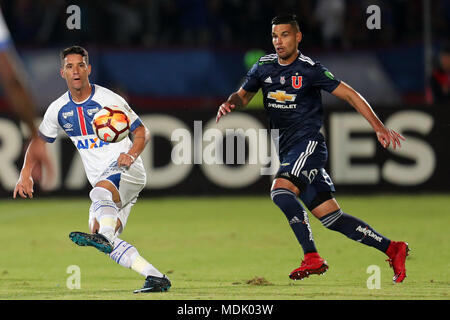 Santiago, Chile. 20th Apr, 2018. Universidad de Chile's Alejandro Contreras (R) vies for the ball with Thiago Neves (L) of Cruzeiro of Brazil during their Copa Libertadores match at the National stadium in Santiago, Chile, 19 April 2018. Credit: Mario Ruiz/EFE/Alamy Live News - Stock Photo