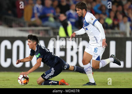 Santiago, Chile. 20th Apr, 2018. Universidad de Chile's Angelo Araos (L) vies for the ball with Cruzeiro's Lucas Silva during the Copa Libertadores soccer match between Universidad de Chile and Cruzeiro at Nacional stadium in Santiago de Chile, Chile, 19 April 2018. Credit: Mario Ruiz/EFE/Alamy Live News - Stock Photo