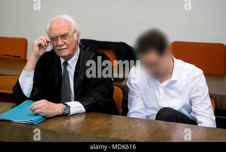20 April 2018, Germany, Munich: A 38-year-old defendant (r) sits in court next to his lawyer Wilfried Eisell. He is charged with firing shots at a young female police officer at the train station of Unterfoehring near Munich in June of last year. Photo: Sven Hoppe/dpa - ATTENTION: individual(s) has/have been pixelated for legal reasons - Stock Photo