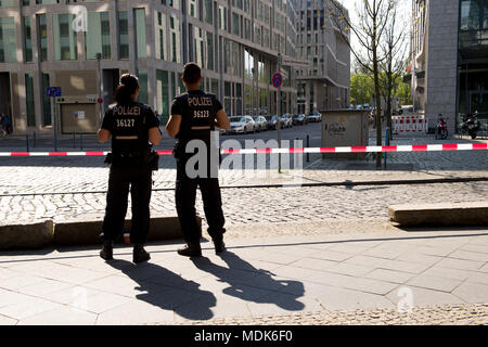 Berlin, Germany. 20th Apr, 2018. 20 April 2018, Germany, Berlin: Police officers patrol the evacuated area outside the main station as a WWII bomb is being defused nearby. Credit: Lisa Ducret/dpa/Alamy Live News - Stock Photo