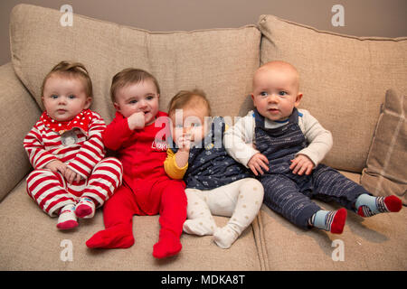 Parents trying to entertain babies - Stock Photo
